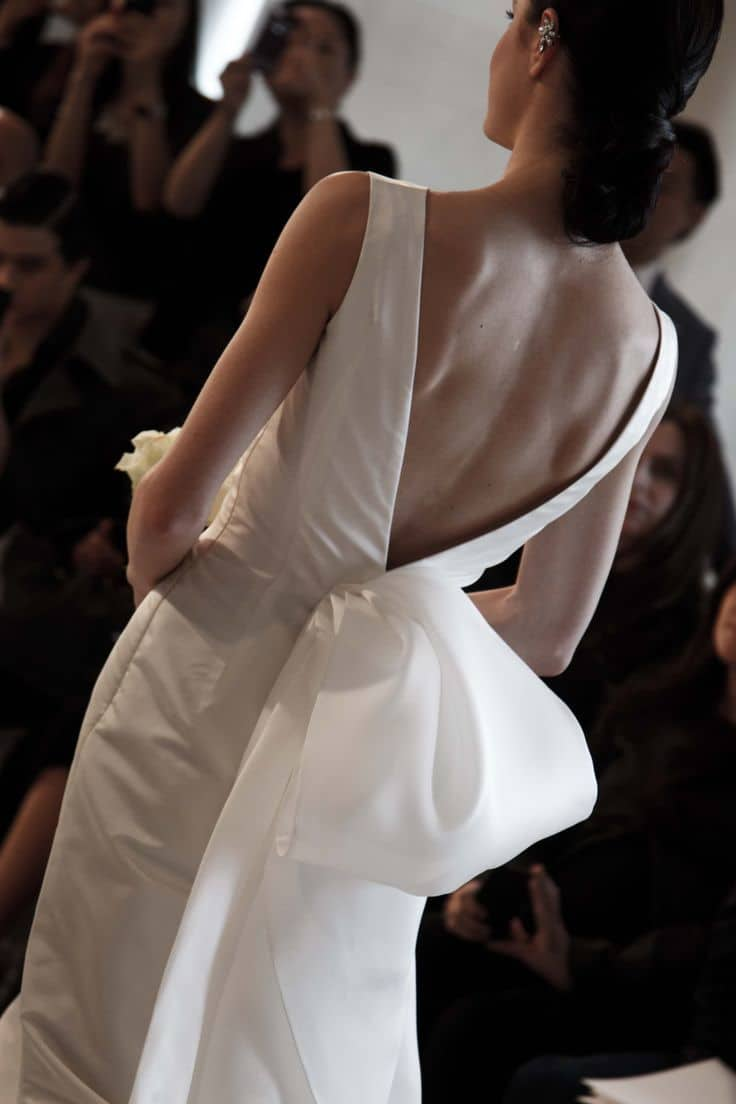 wedding dress with a v-shaped back resulting in an oversized bow