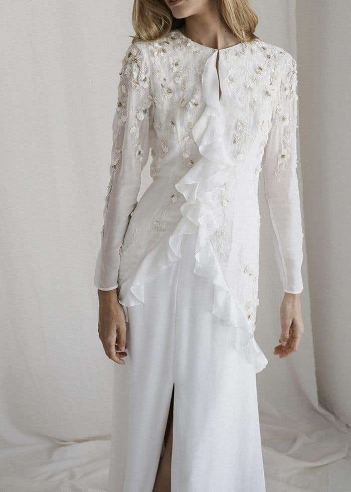 a wedding dress with floral details by Bo and Luca Fashion House