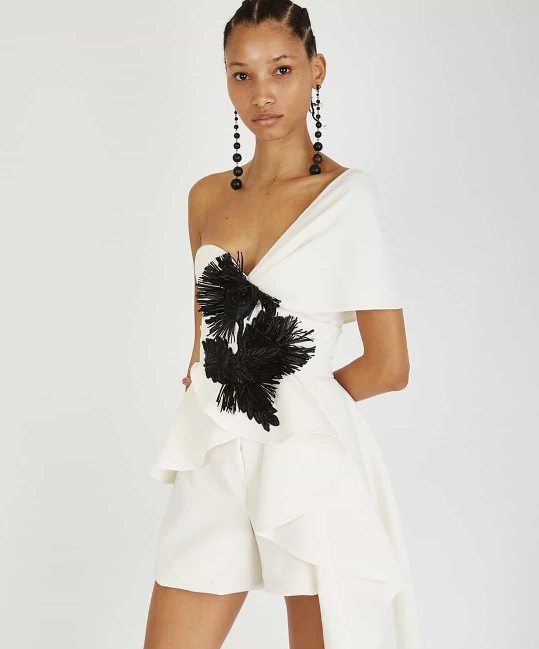 a short wedding dress with black and white details by Oscar de la Renta