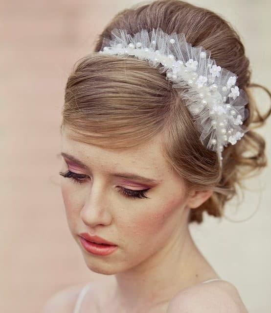 bride's hair styling with ribbon