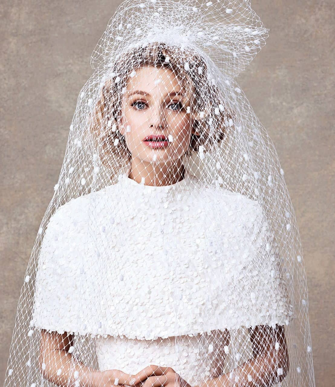 bride's hairstyling with lace veil