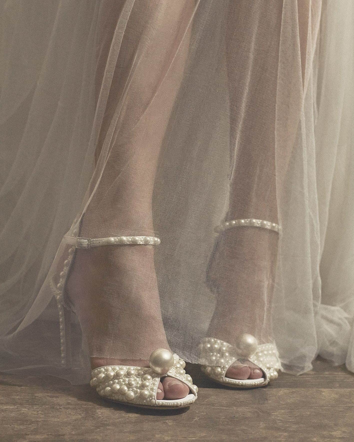 bride's wedding shoes with pearls