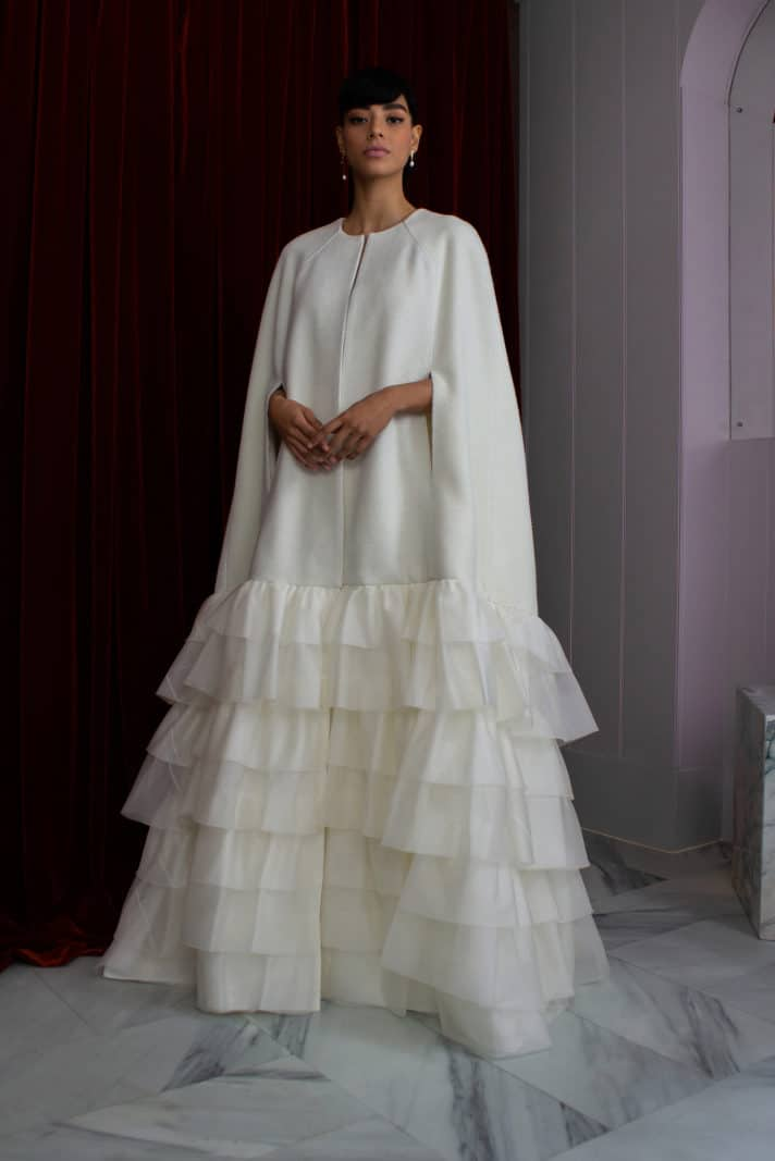 a wedding dress with cape by Halfpenny London