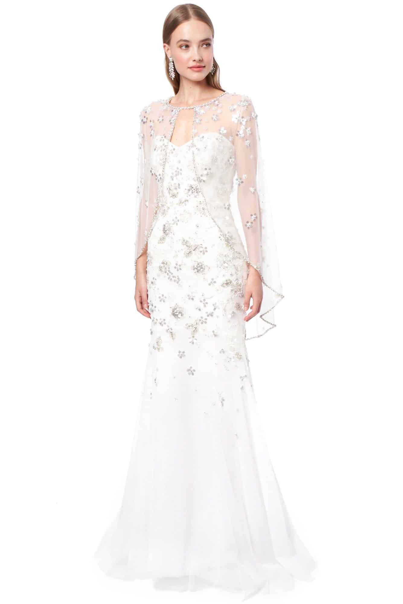 a wedding dress with cape by Jenny Packham