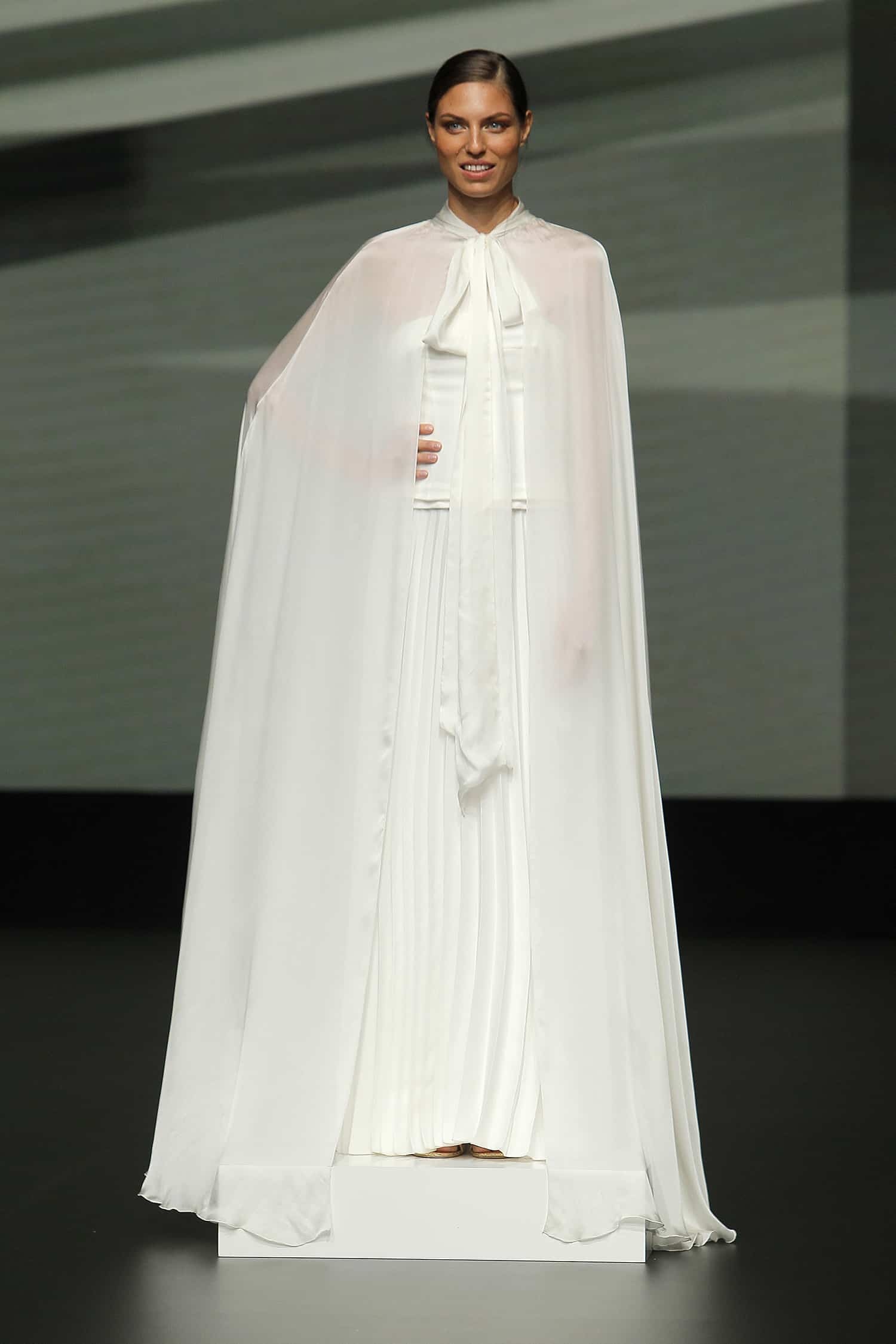 a wedding dress with cape by Marylise
