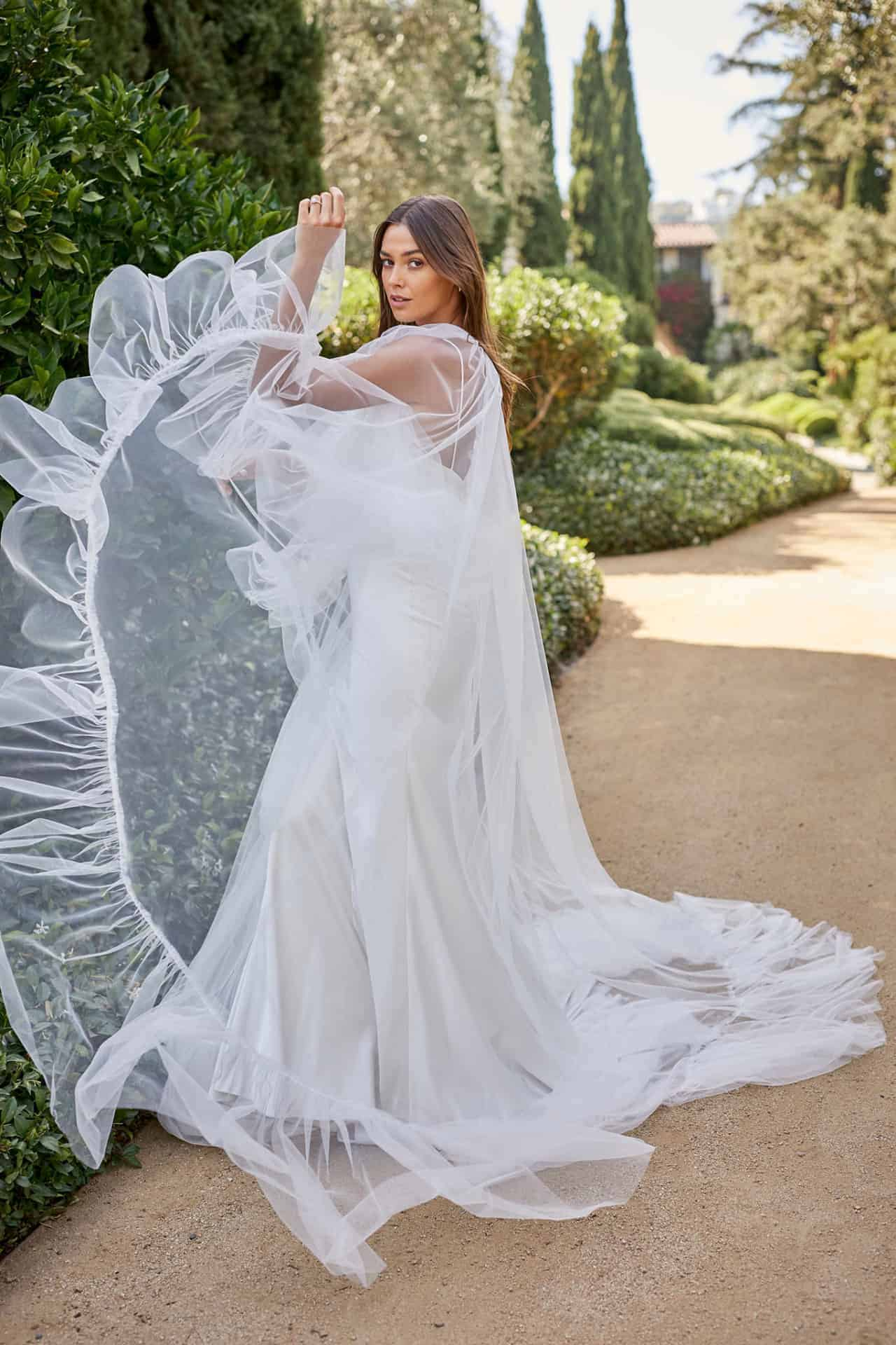 a wedding dress with cape by Monique Lhuillier