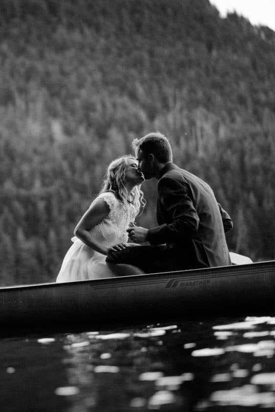 bride and groom kissing in a boat