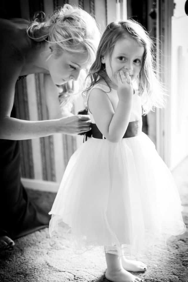 flower girl looking the photographer