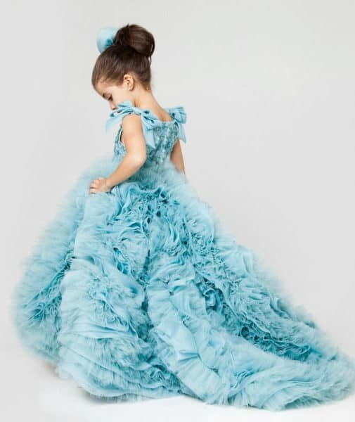 flower girl with a blue dress by Krikor Jobatian