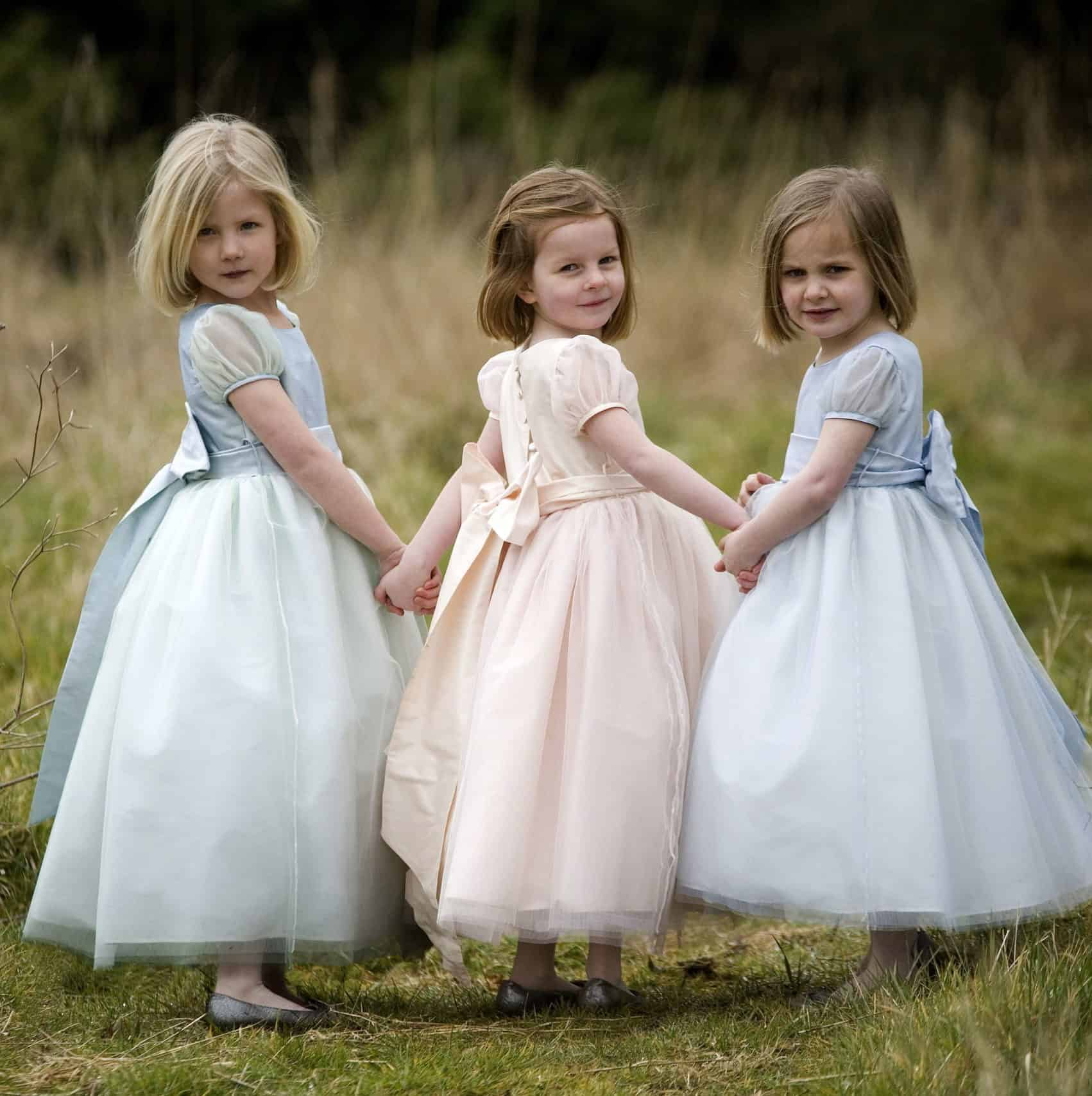 flower girls with classic royal style dresses in blue and pink by Nicki Macfarlane