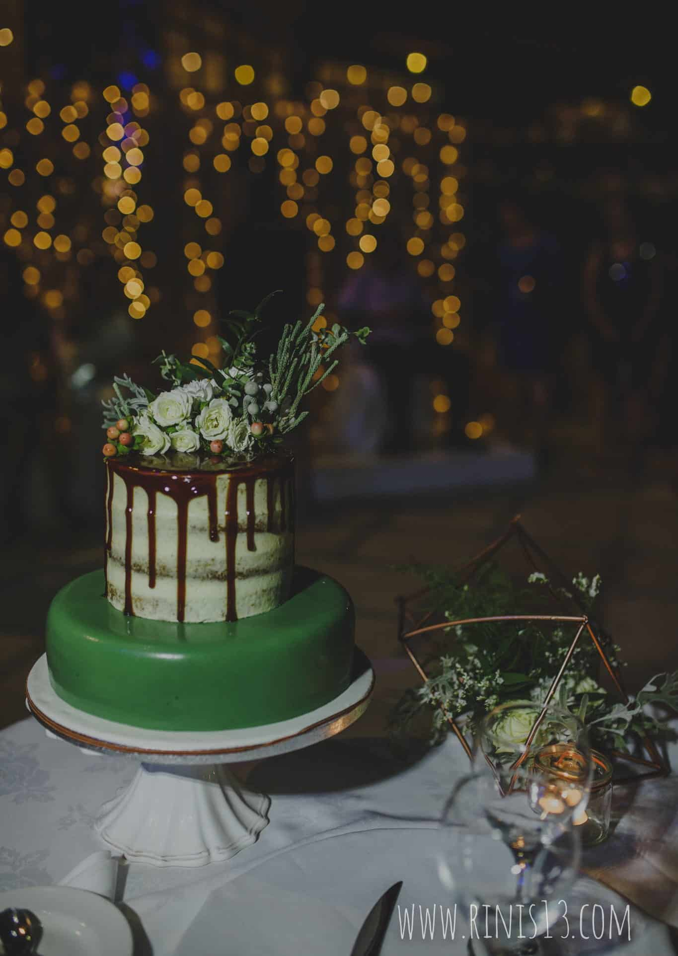 wedding cake in green shades and flowers
