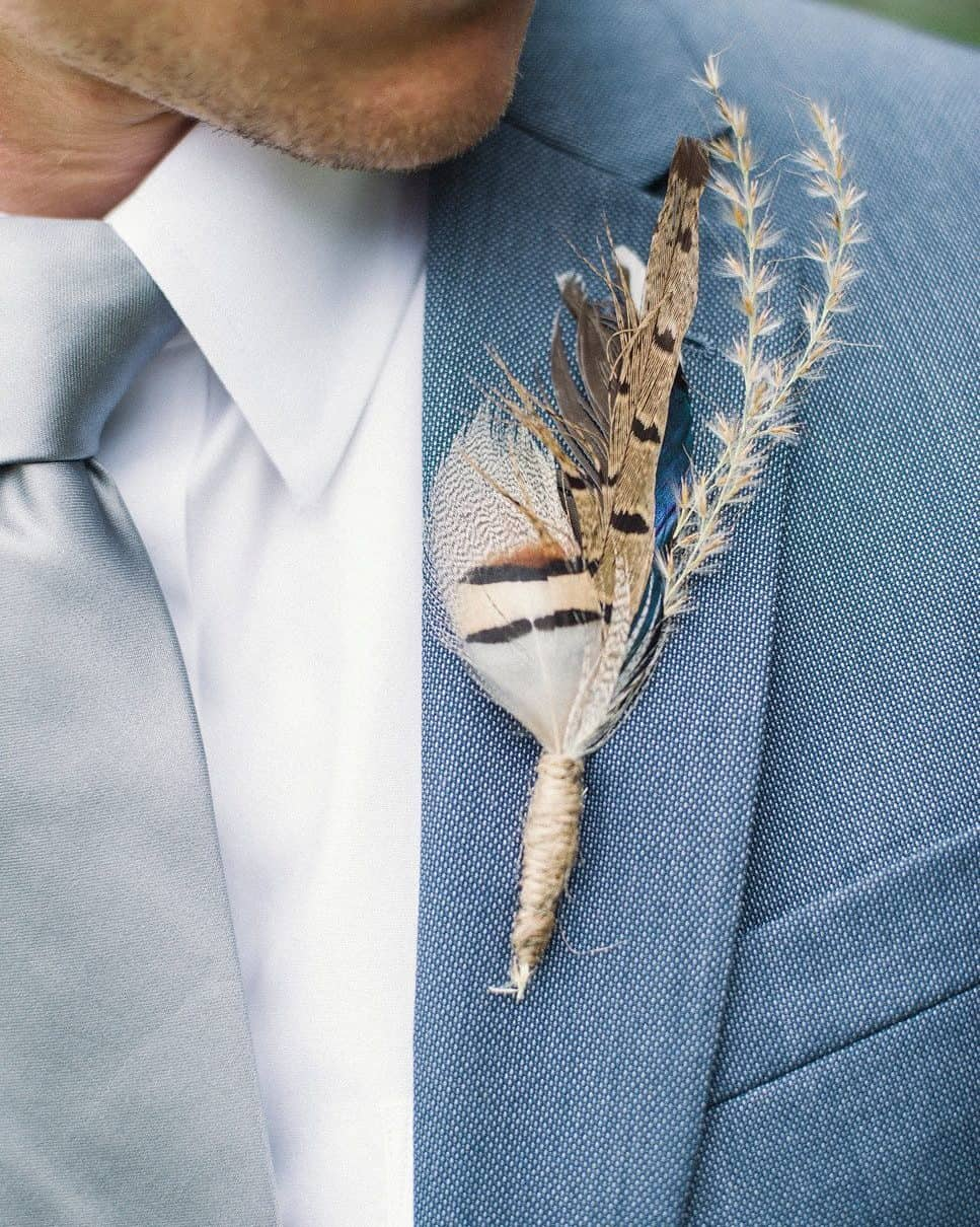 groom boutonniere with feather