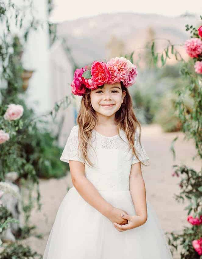 flower girl with a pink floral head peace