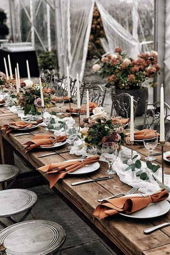 wedding table decoration in dusty orange colours
