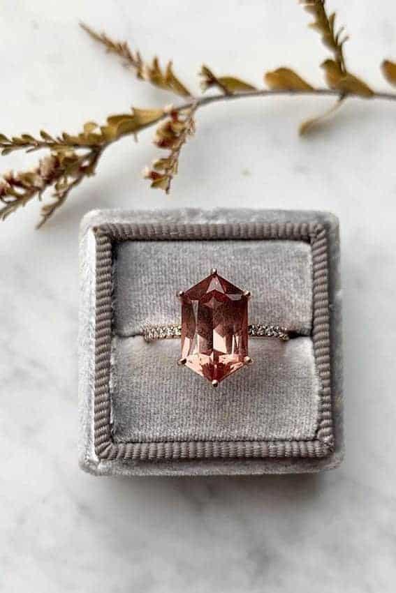 wedding ring with dusty orange diamond