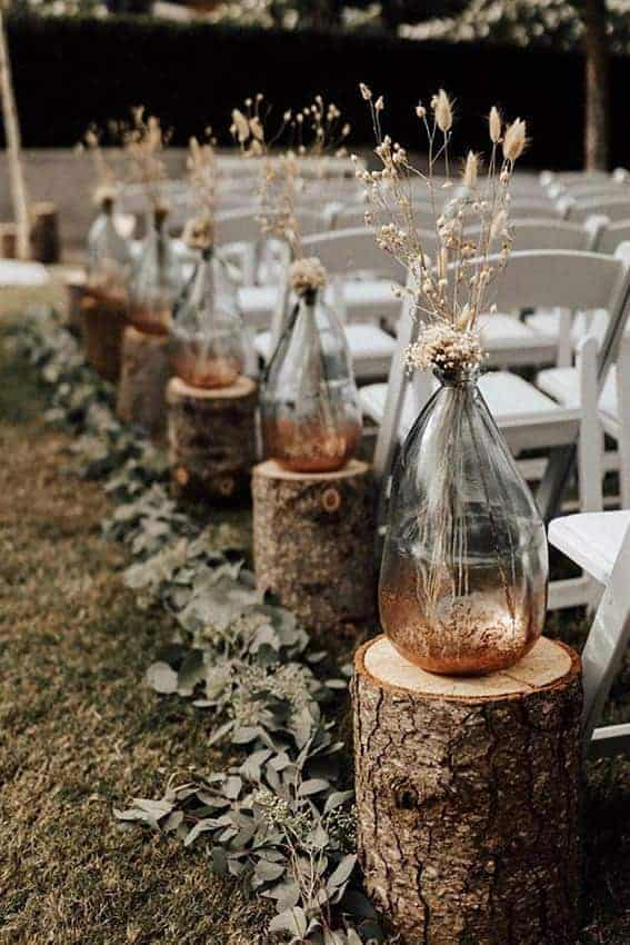 wedding decoration clear bottles with dried flowers