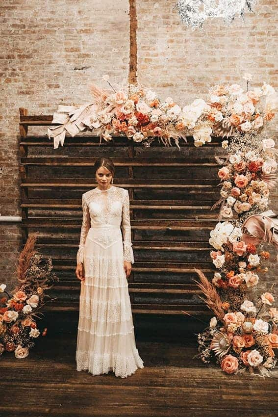wedding backdrop with flowers in dusty orange colours