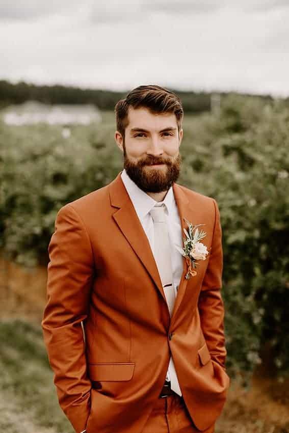 groom with dusty orange suit