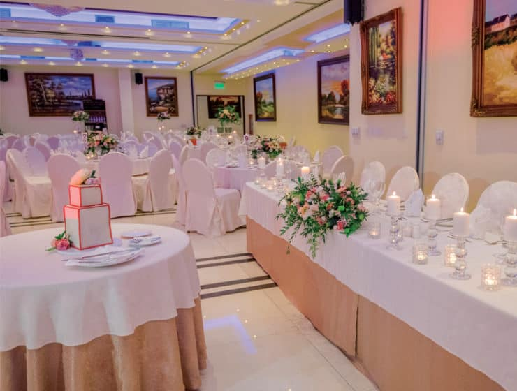 Decorated wedding reception tables in pink, at Semeli Hotel in Nicosia.