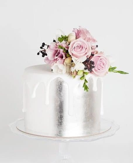 silver wedding cake and roses