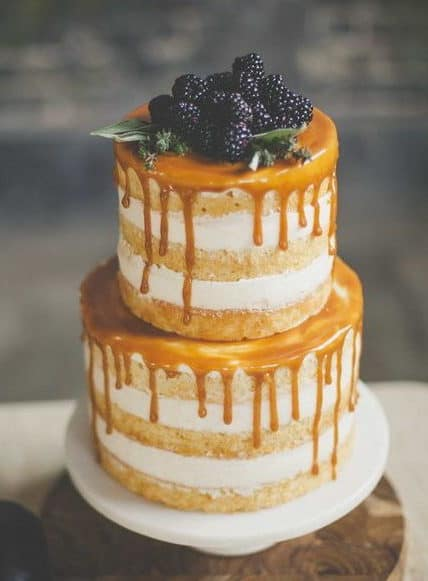 naked wedding cake with caramel and blackberries