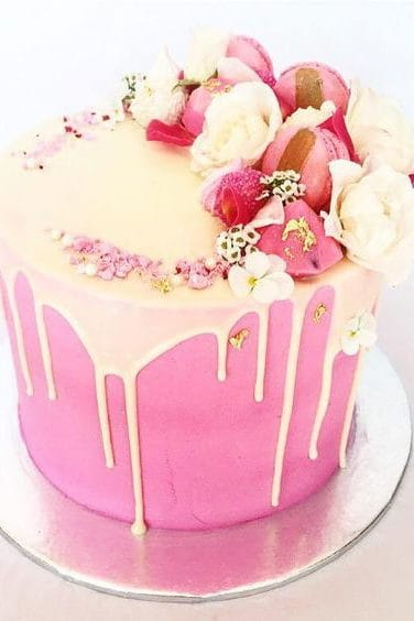 pink wedding cake and macarons