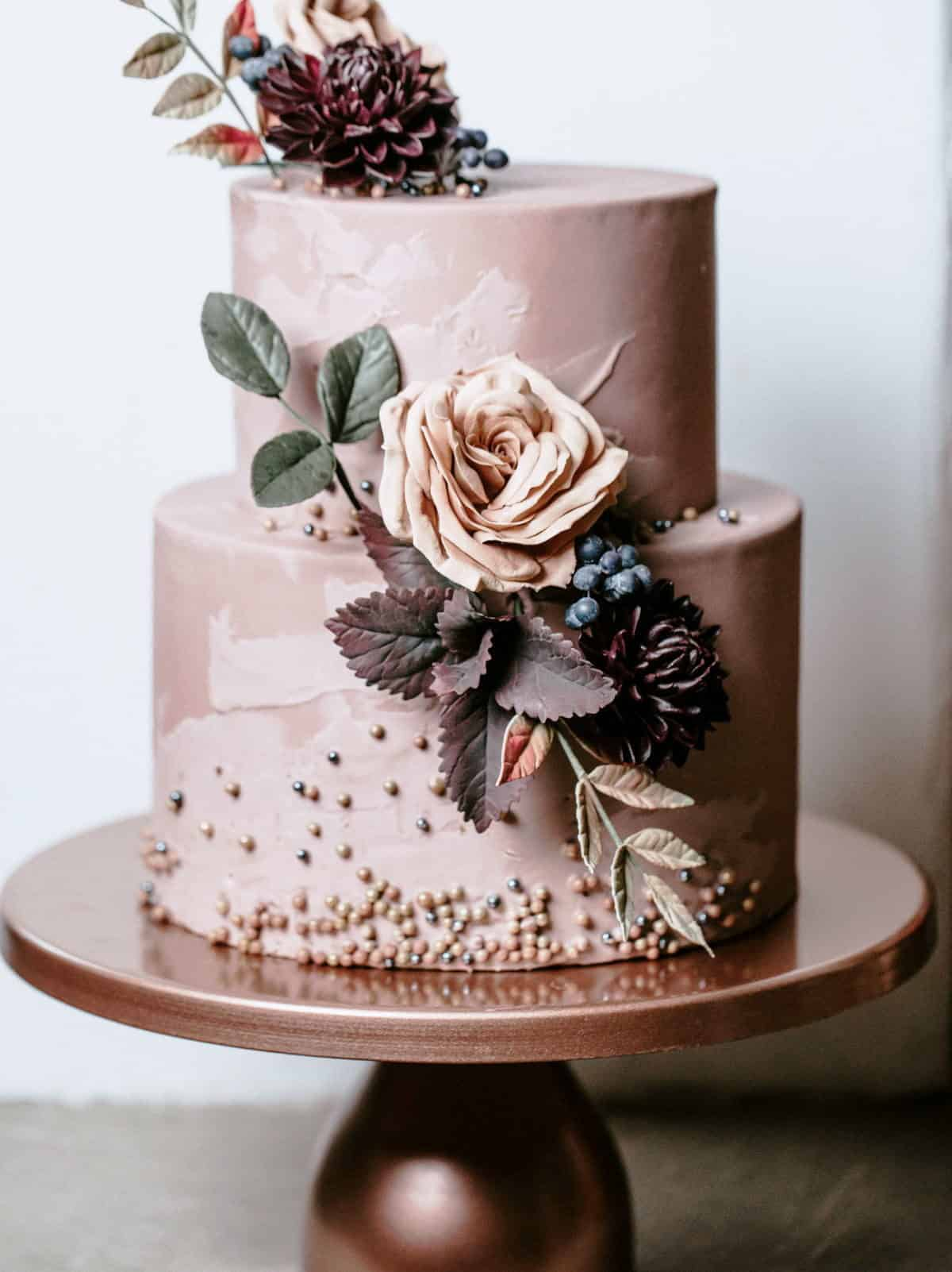 dusty pink wedding cake with flowers