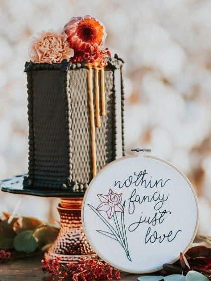 geometric grey wedding cake with flowers
