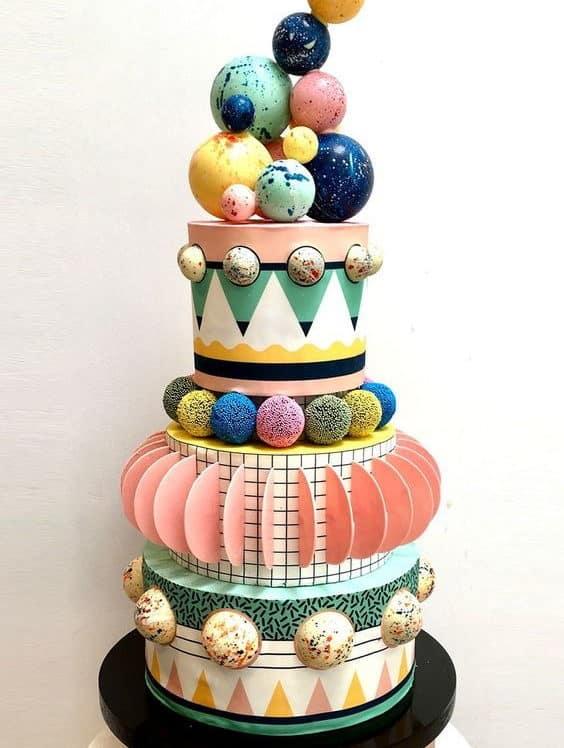 playful wedding cake with spheres