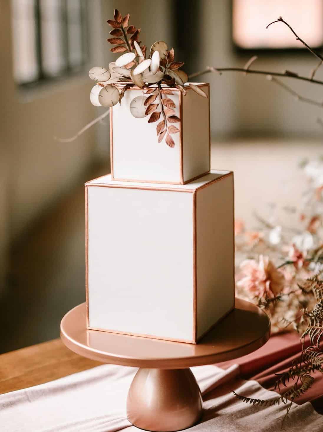 geometric wedding cake with dried leaves