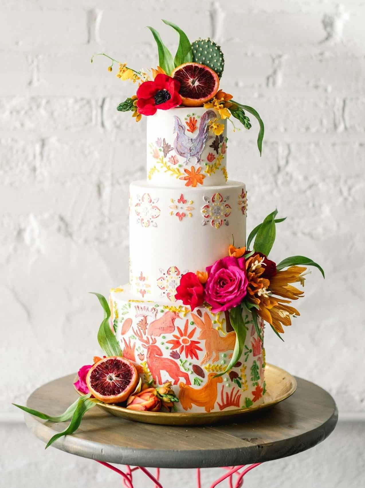painted wedding cake with cactus flowers and fruits