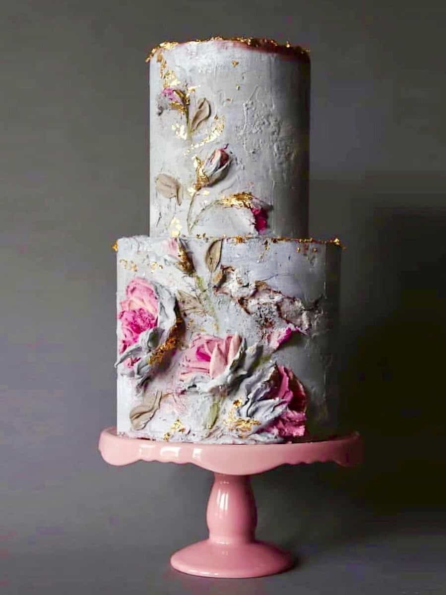 flower painted and concrete texture wedding cake