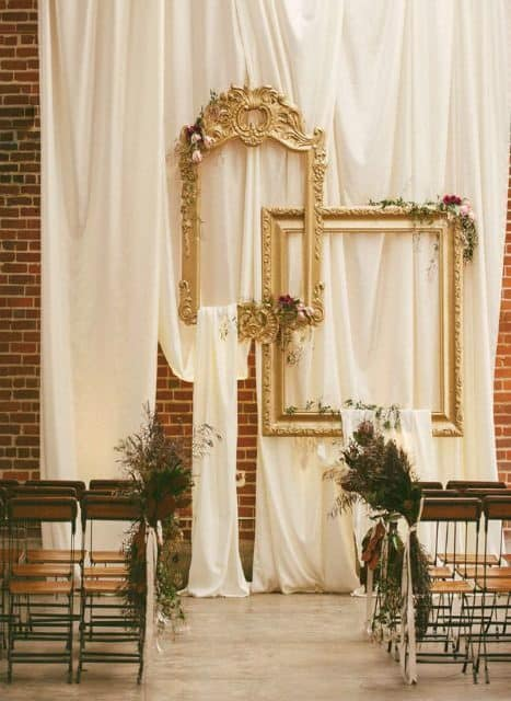 backdrop decoration with fabrics and gold frames