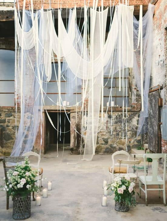backdrop decoration with wooden frame and with airy white fabrics