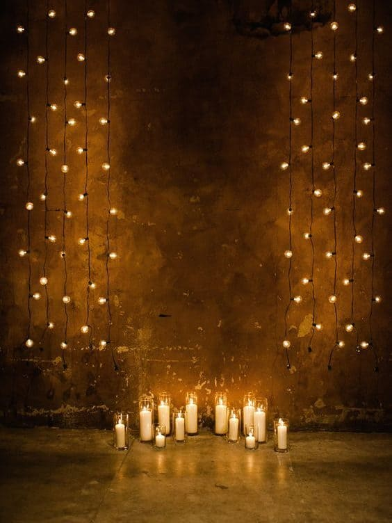 backdrop decoration with fairy lights and candles
