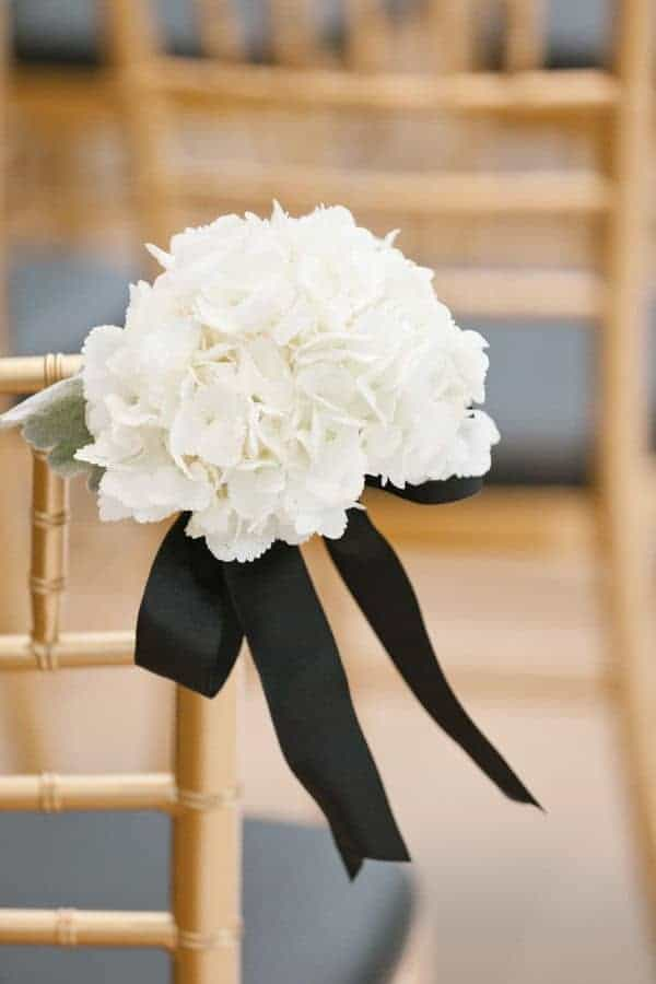 wedding decoration with white flower and black bow