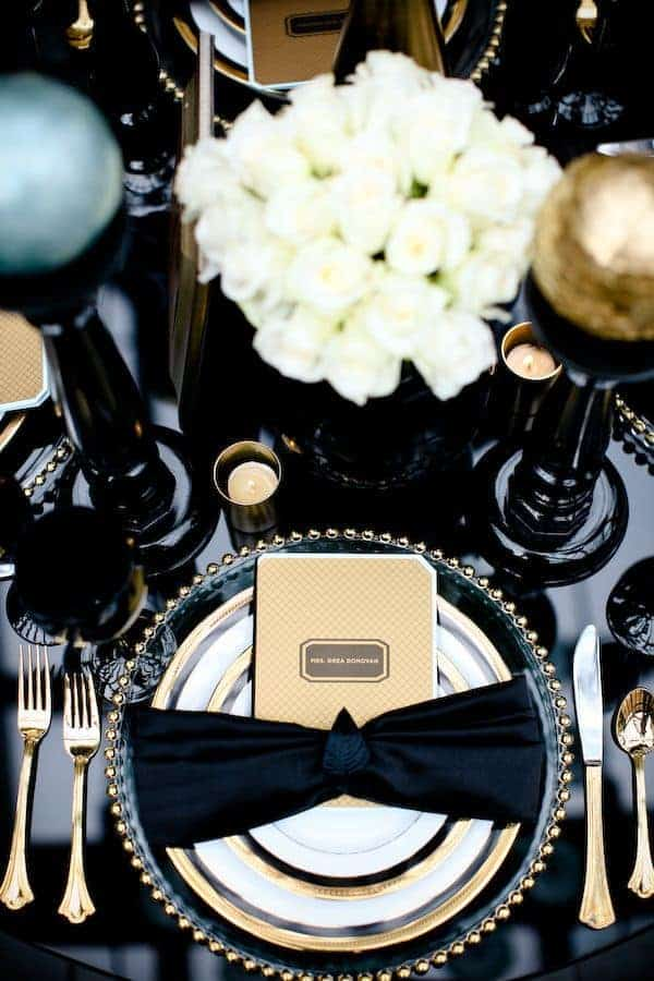 wedding dinner decoration with a black bow on the plate