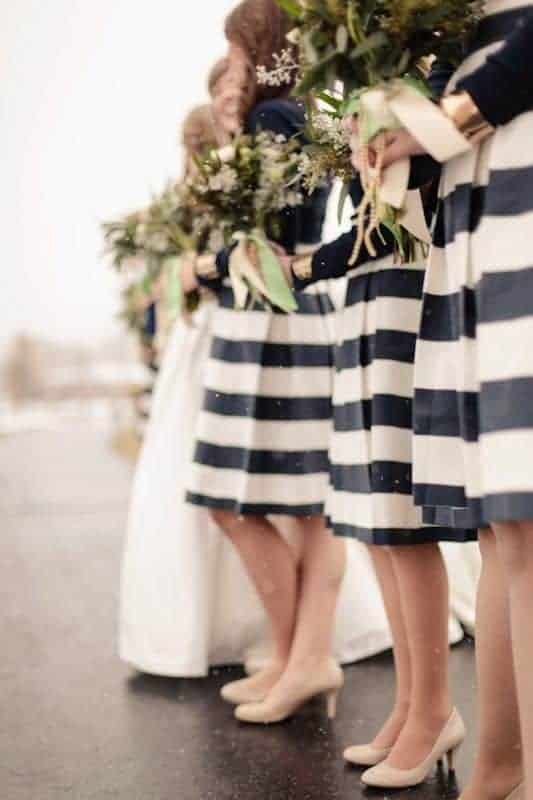 bridesmaids with black and white stipes dresses