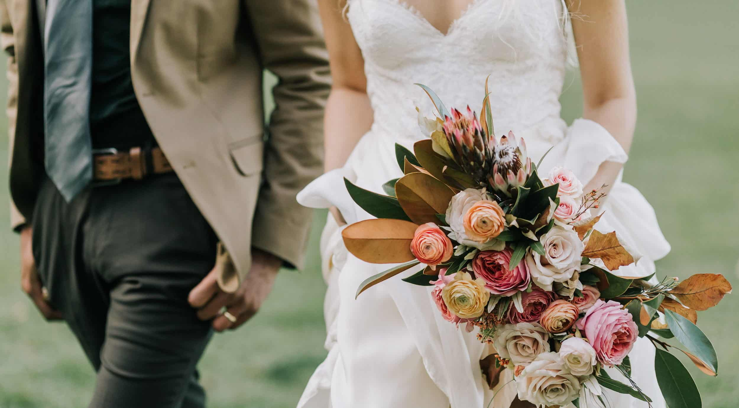 groom and bride with a wedding bouquet