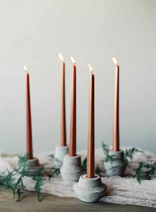 candleholder with concrete and dusty orange candles