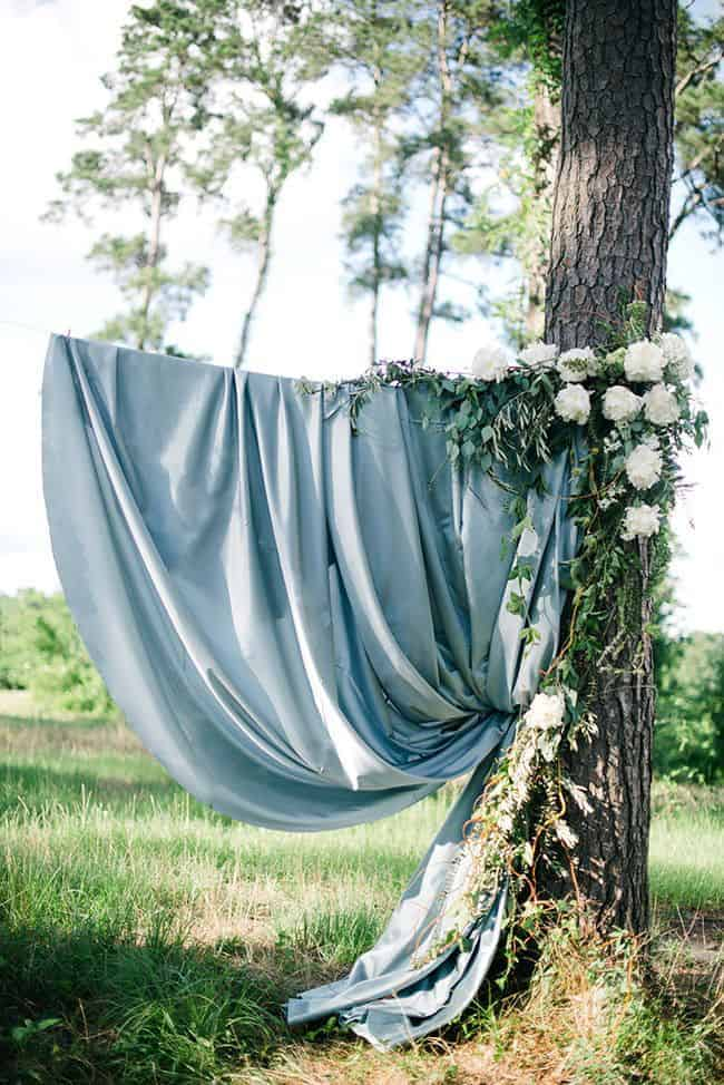 wedding decoration a dusty blue fabric and white flowers