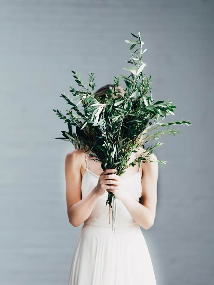 bride with olive leaves bouquet