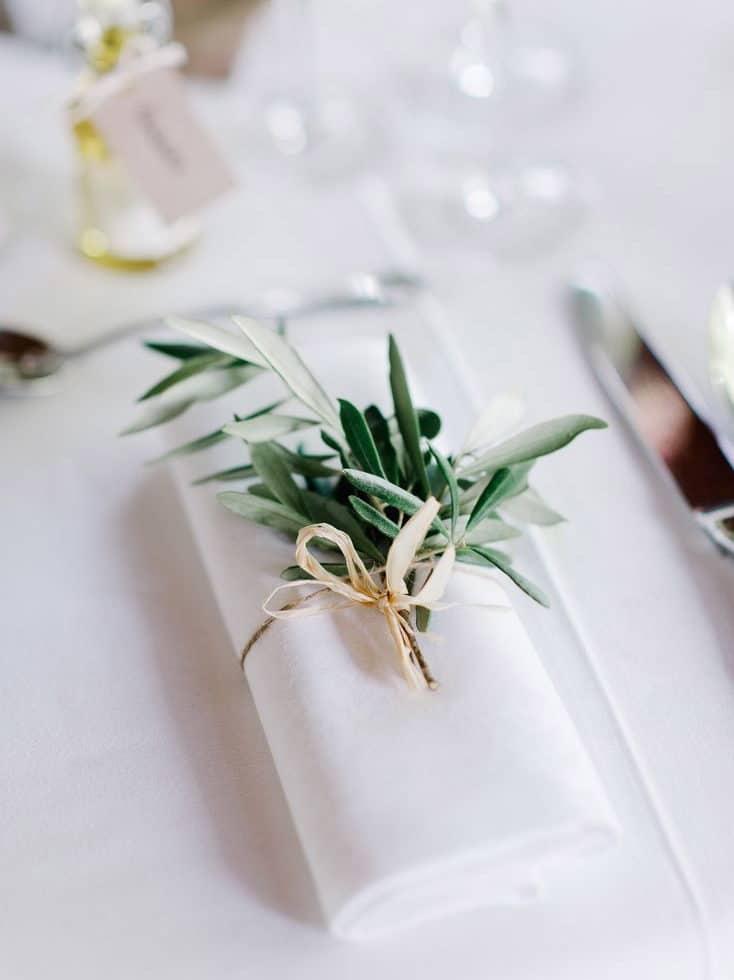 wedding dinner napkin detail with olive leaves