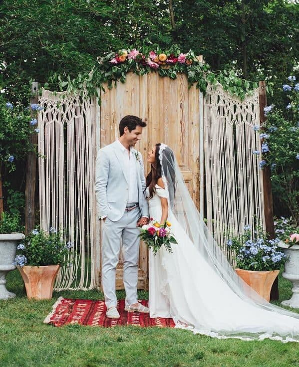 wedding backdrop decoration with crochet and bride and groom