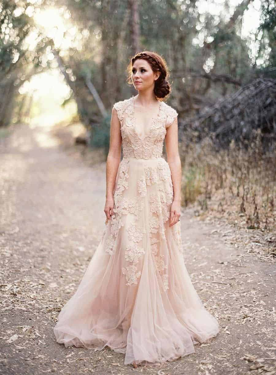 bride in the forest with peach wedding dress