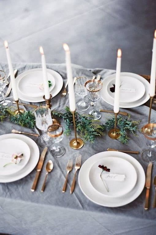 wedding table decoration with grey table cloth and white plates