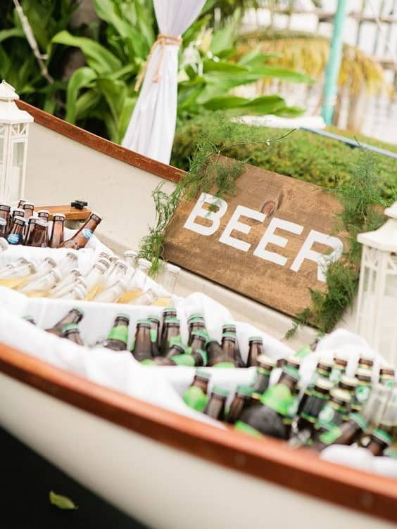summer wedding catering beers in a boat