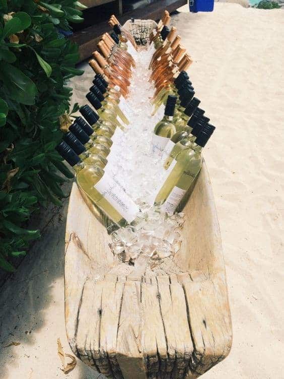 summer wedding catering wooden boat with ice and bottles of wine