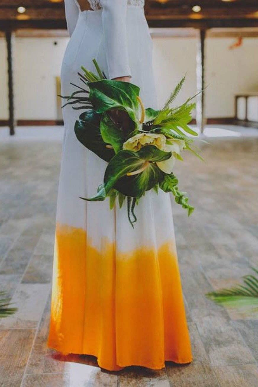 wedding dress white and yellow and tropical wedding bouquet