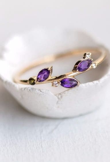 wedding ring with purple stones